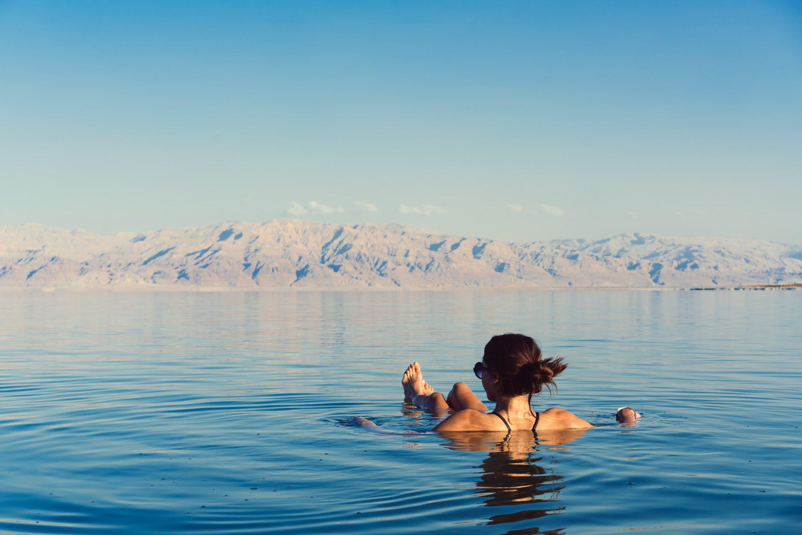 Woman floating in the Dead Sea, Israel