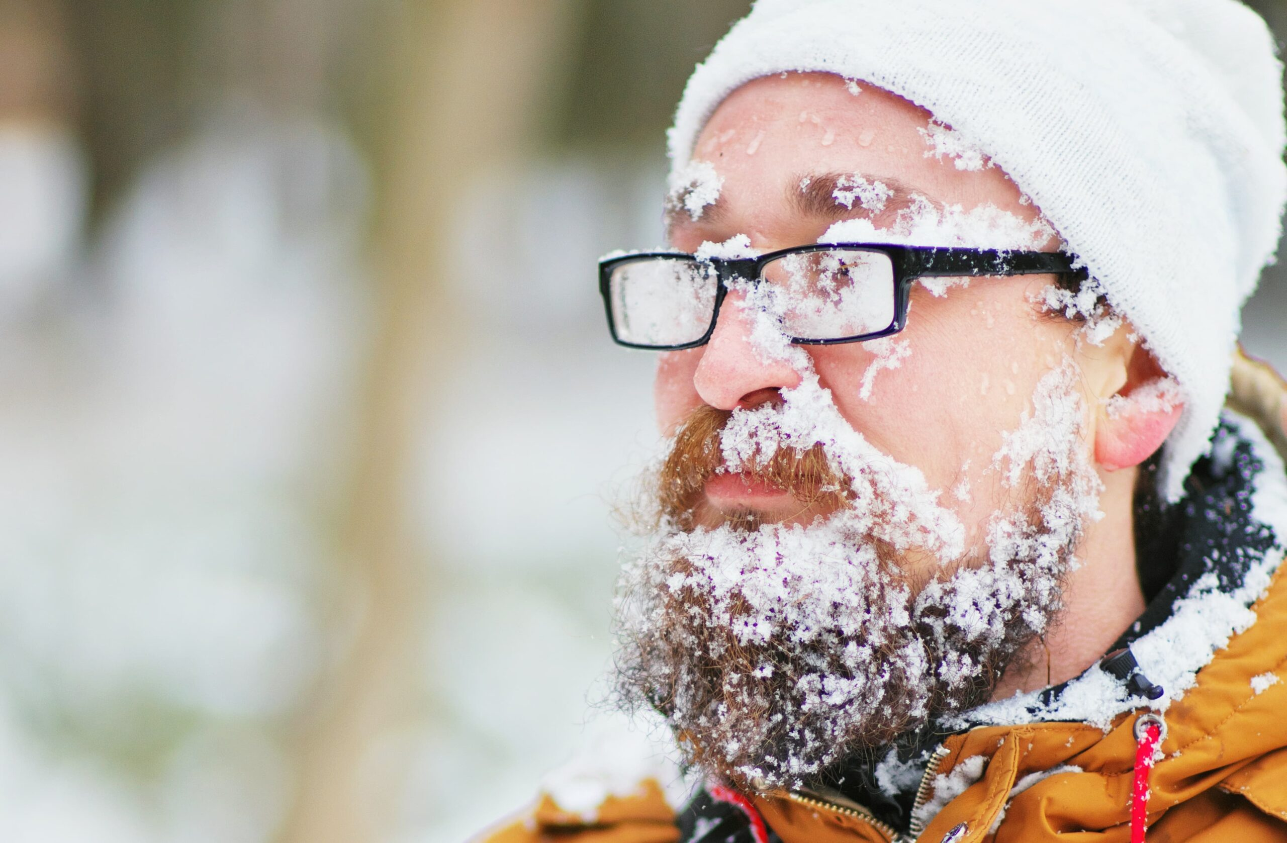 Bearded man with snow on his face