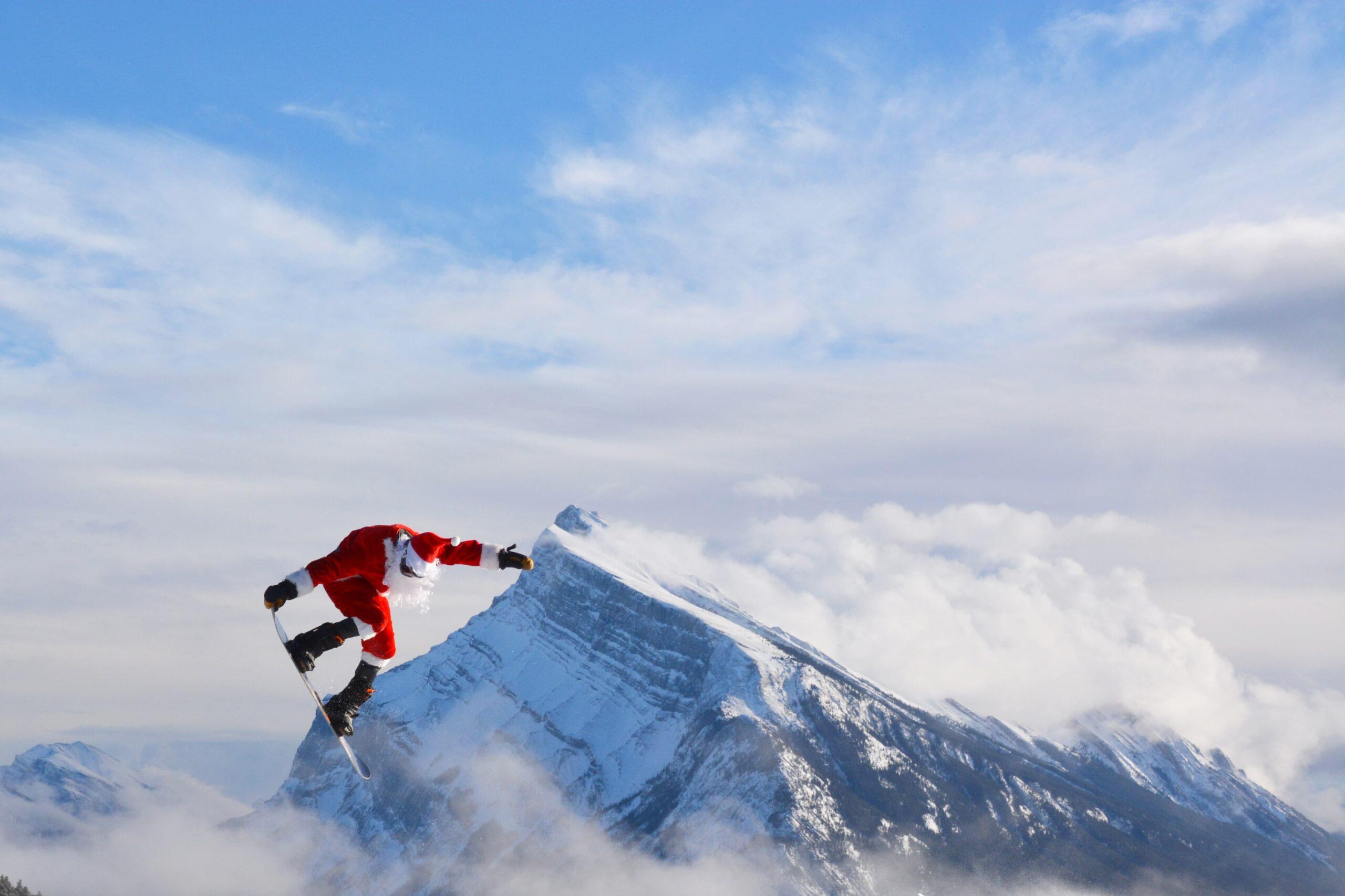 Santa Claus snowboarding