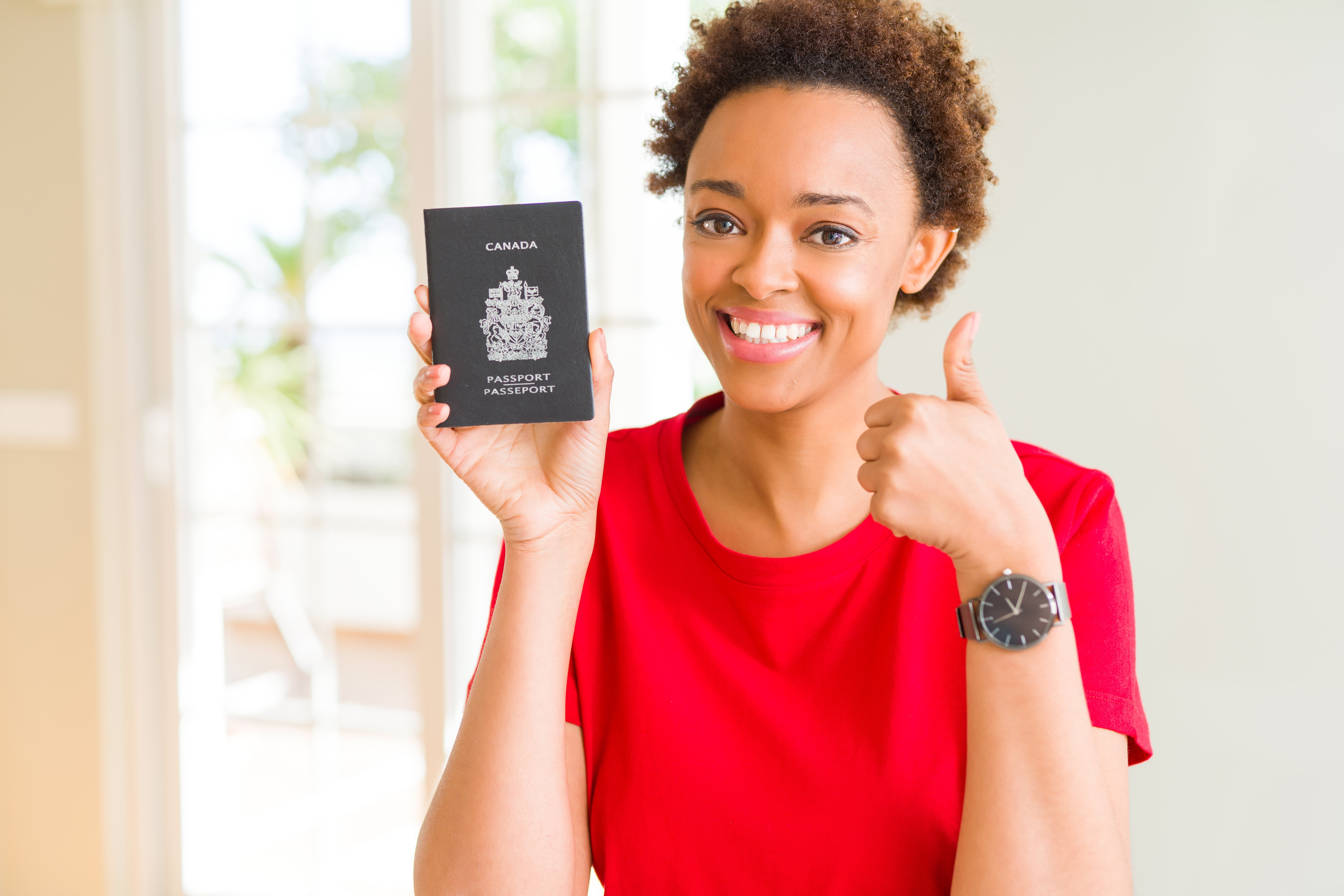 Woman holding passport and smiling