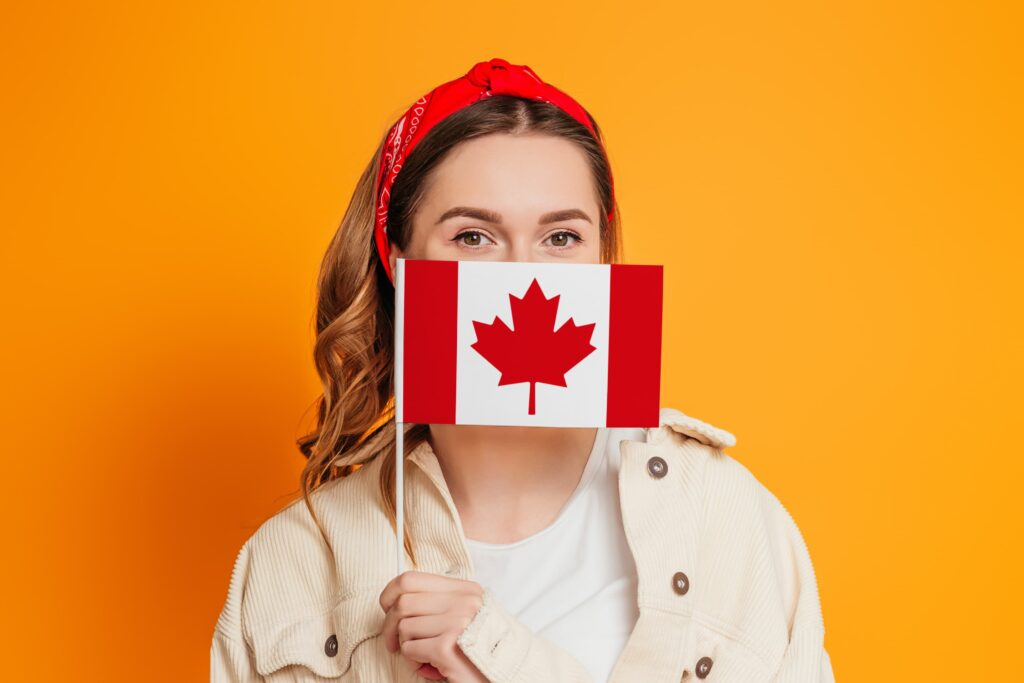Woman holding up a Canadian flag