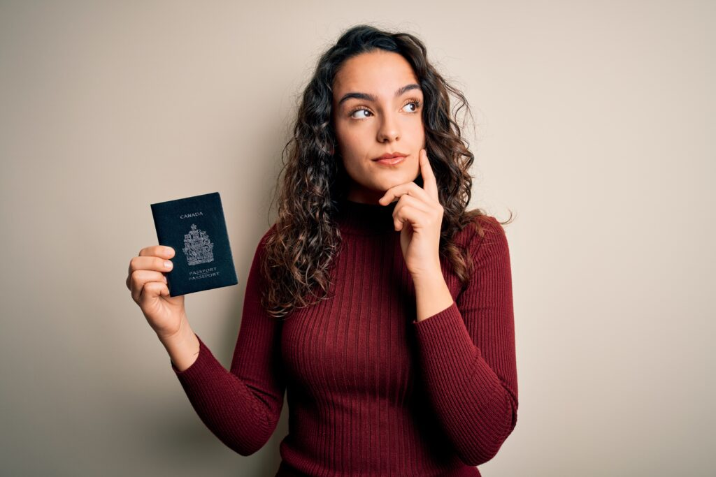 Girl with Canadian passport thinking