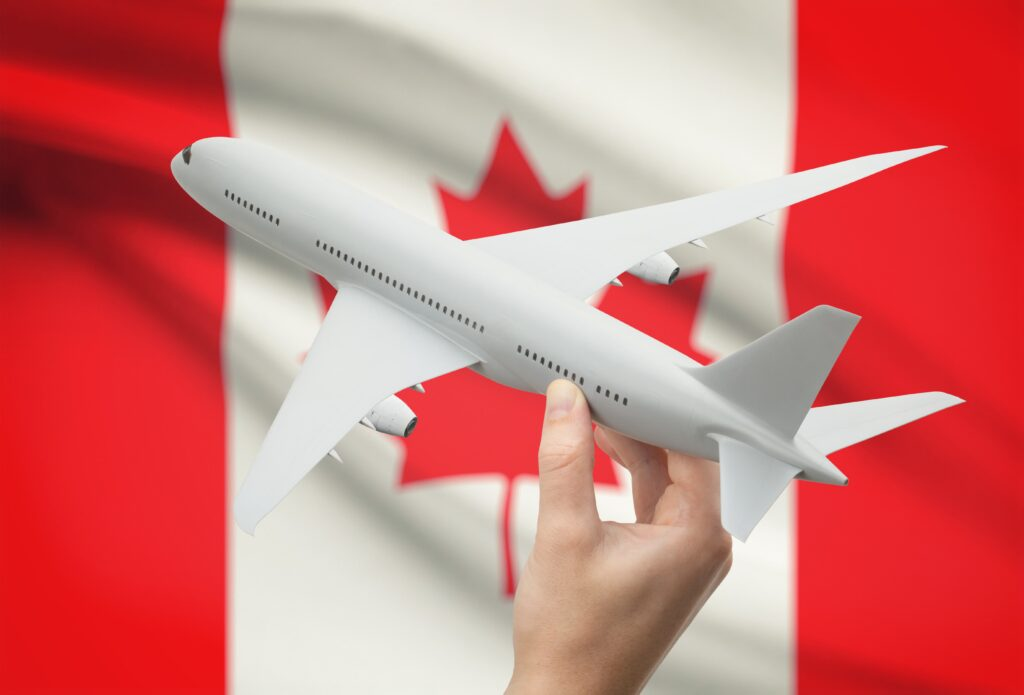 Plane on Canadian flag background