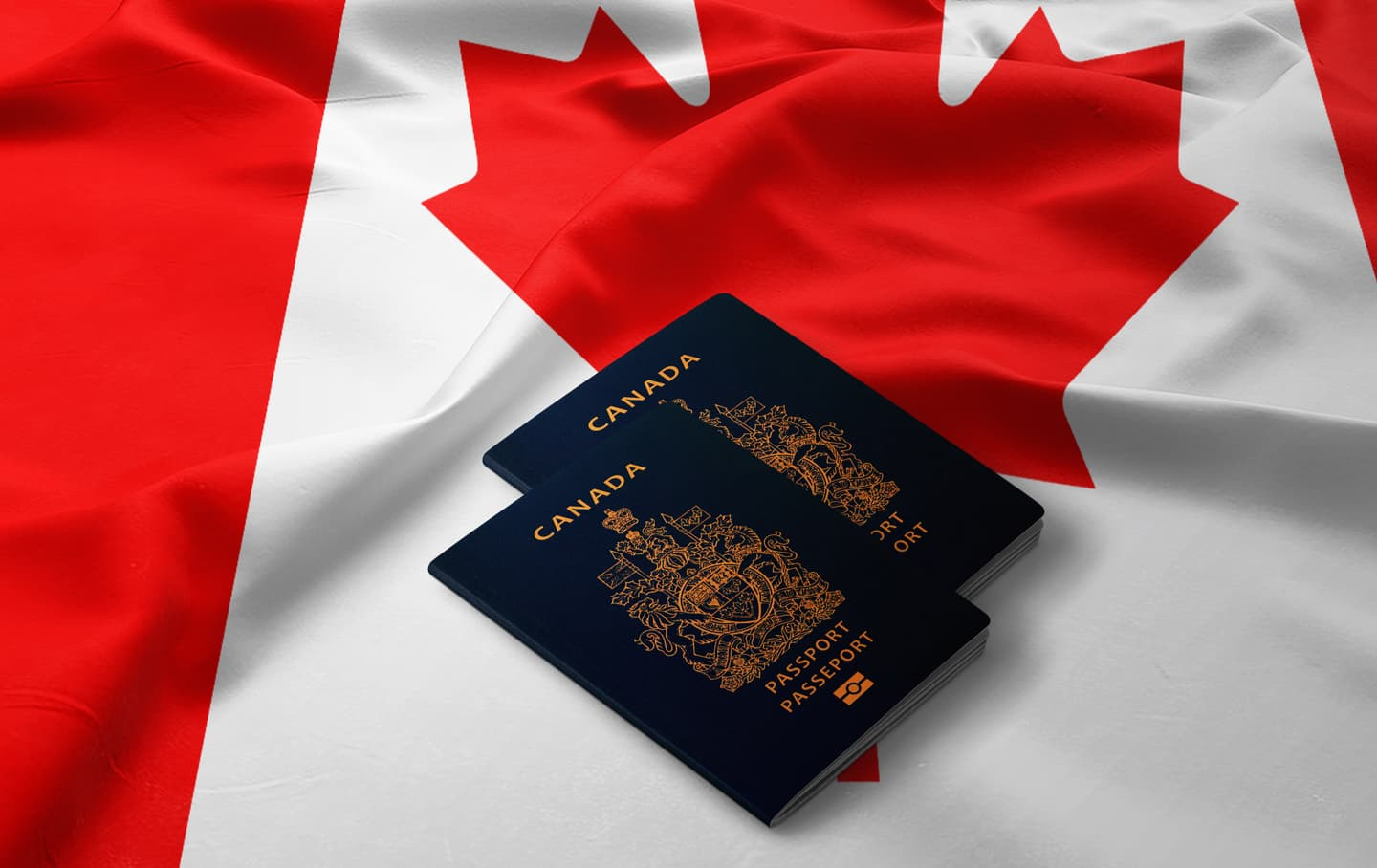 2 Canadian passports on a Canadian flag