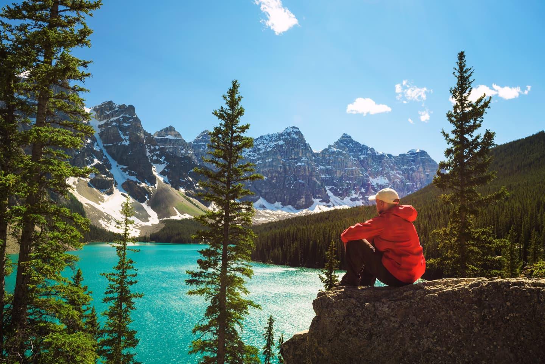 Hiker overlooking Banff National Park Lake