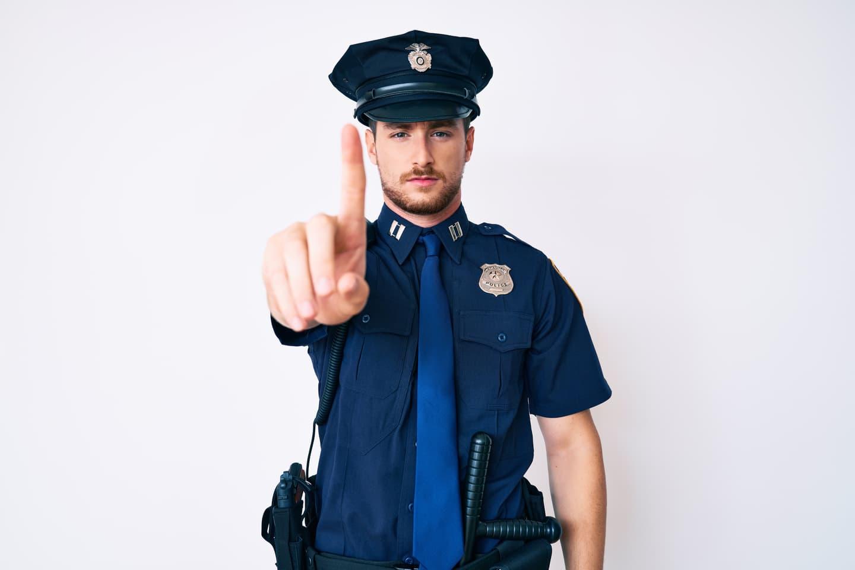 Police officer raising a finger