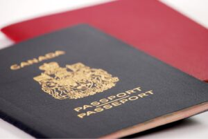 Canadian passport laying on a red background