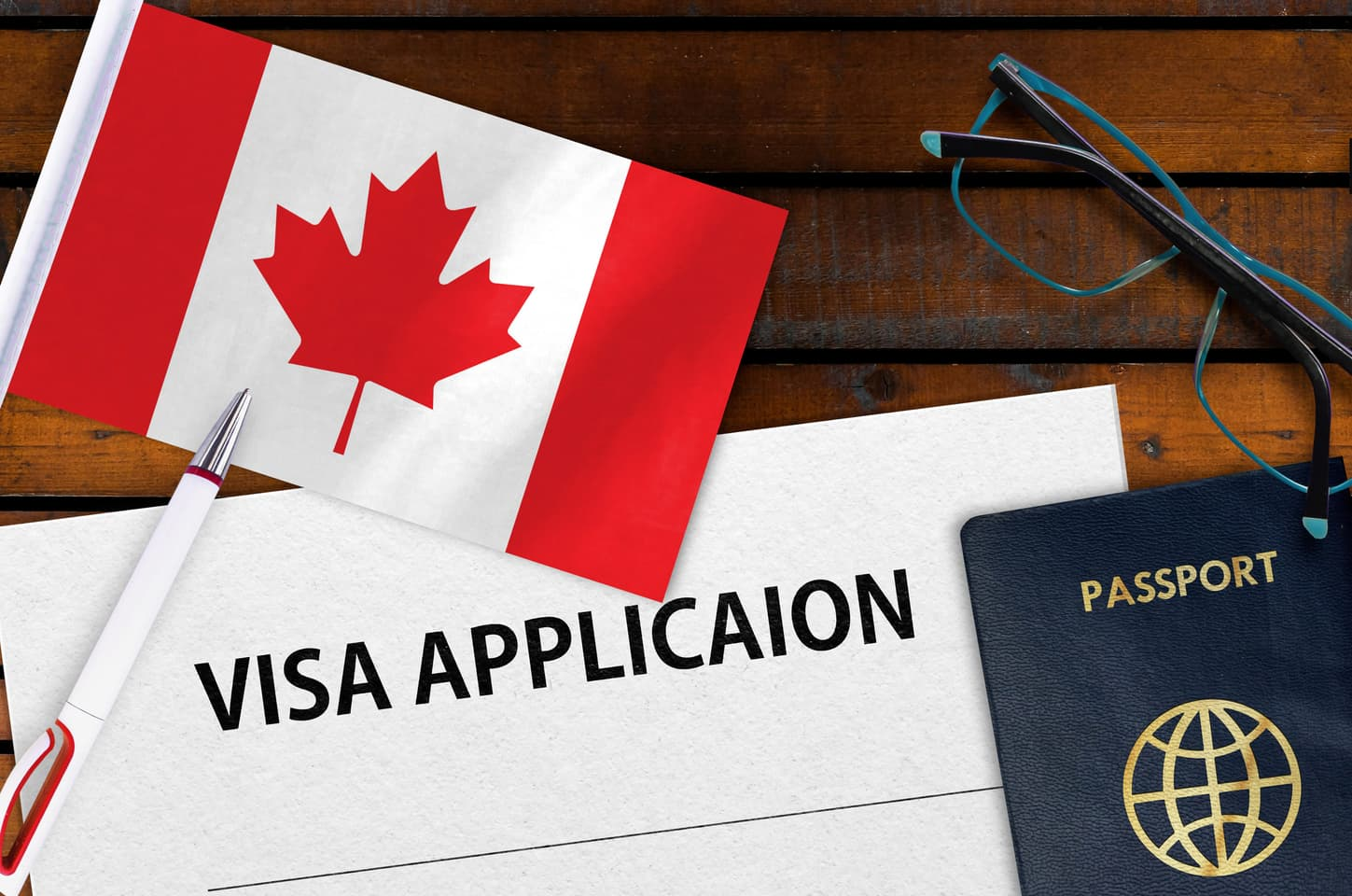 Canadian visa application with flag and passport