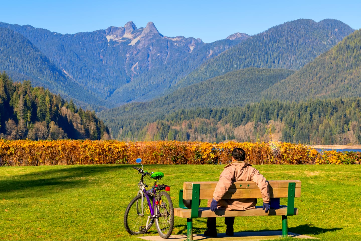 Man sitting on bench North Vancouver Canada